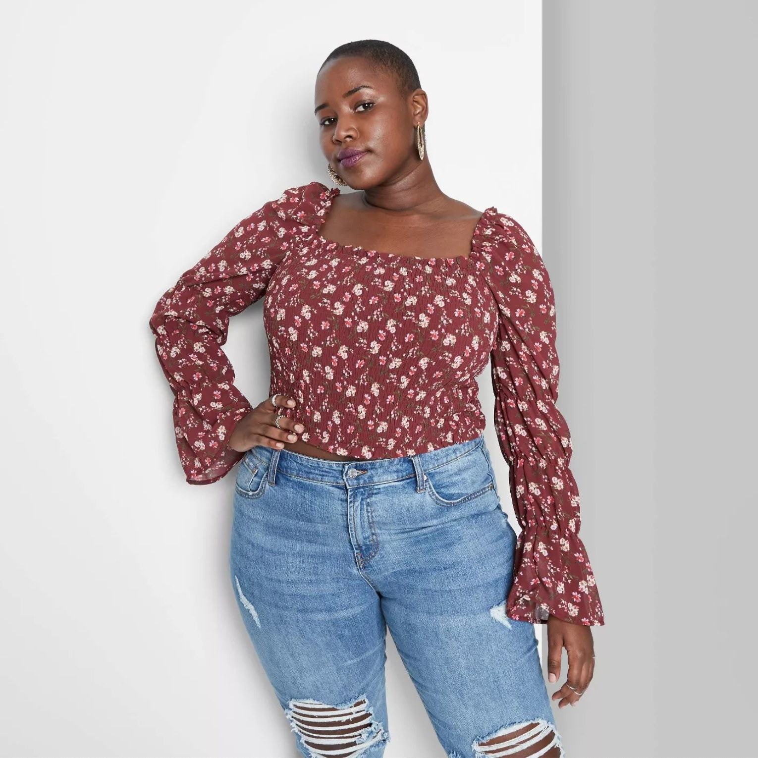 Model wearing the shirt in floral burgundy