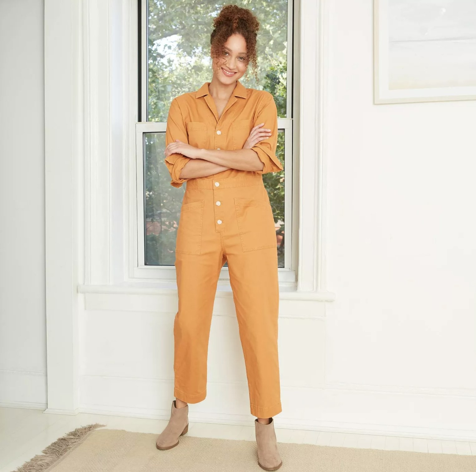 Model wearing the jumpsuit in yellow