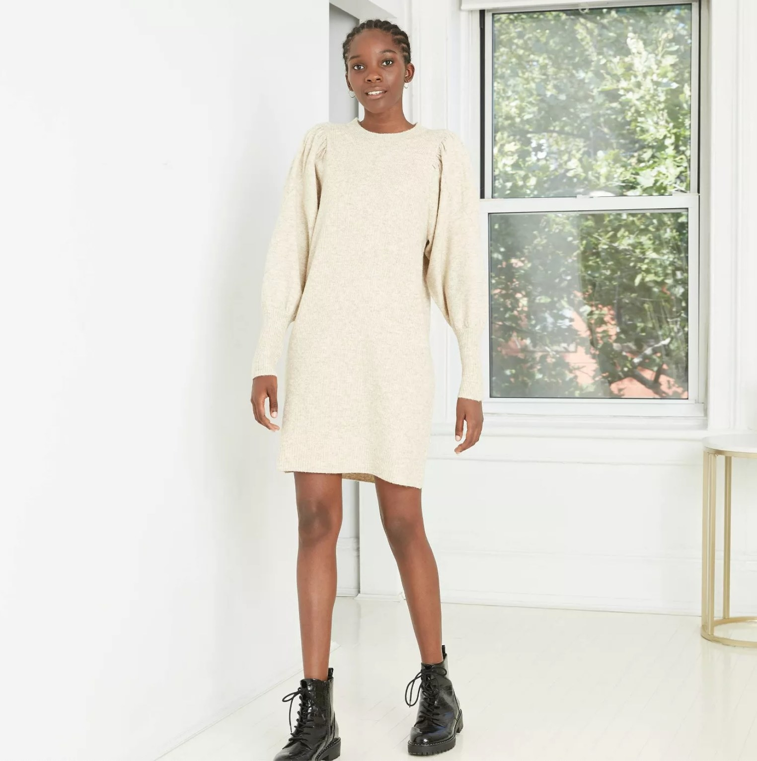 The model wearing the dress in cream