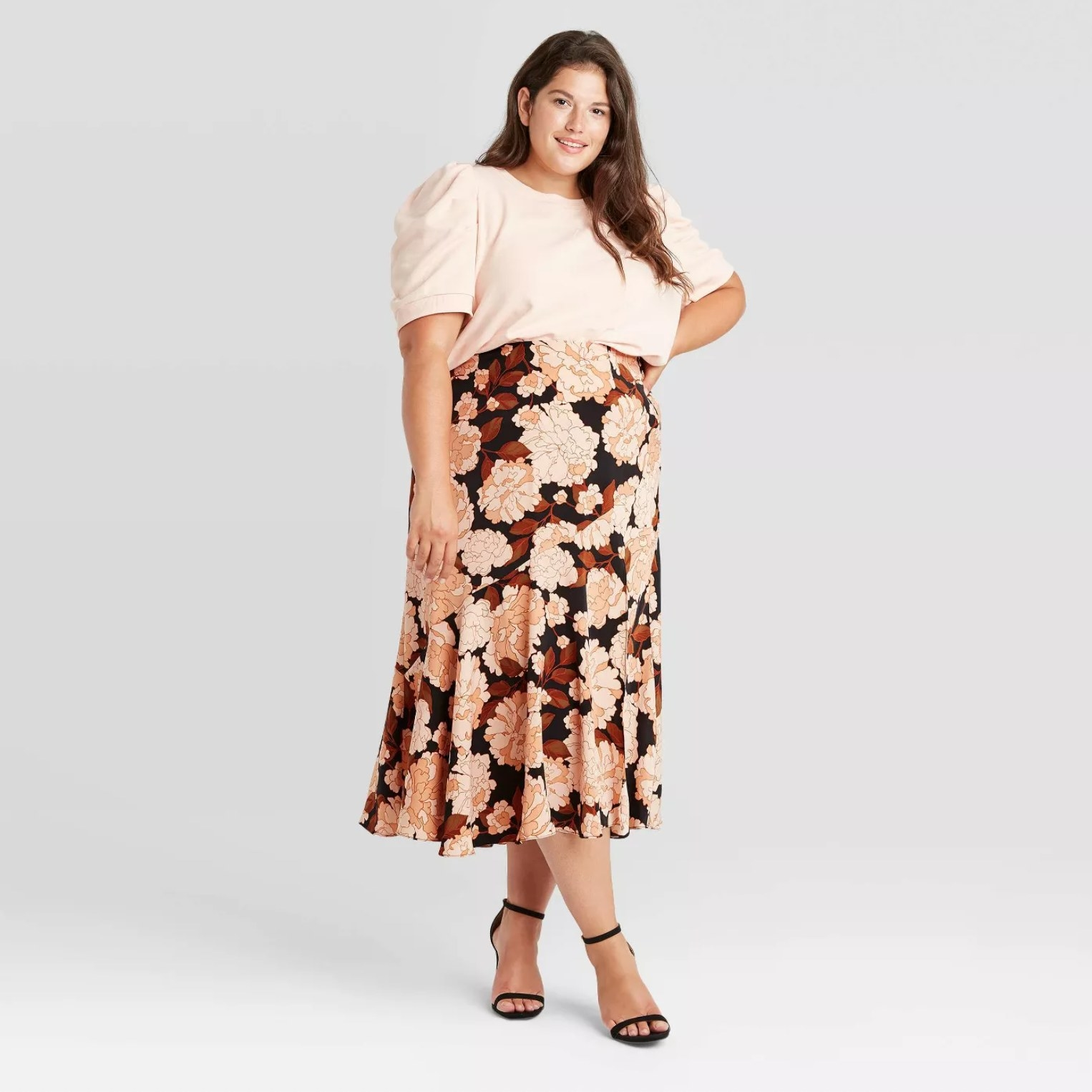 Model wearing the skirt in floral pink