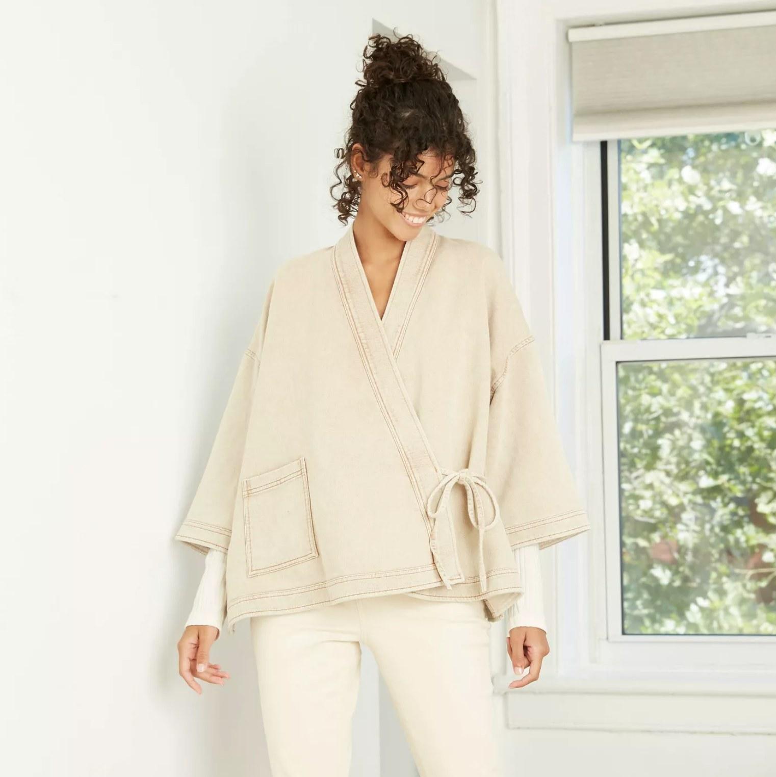 Model wearing the cream coat