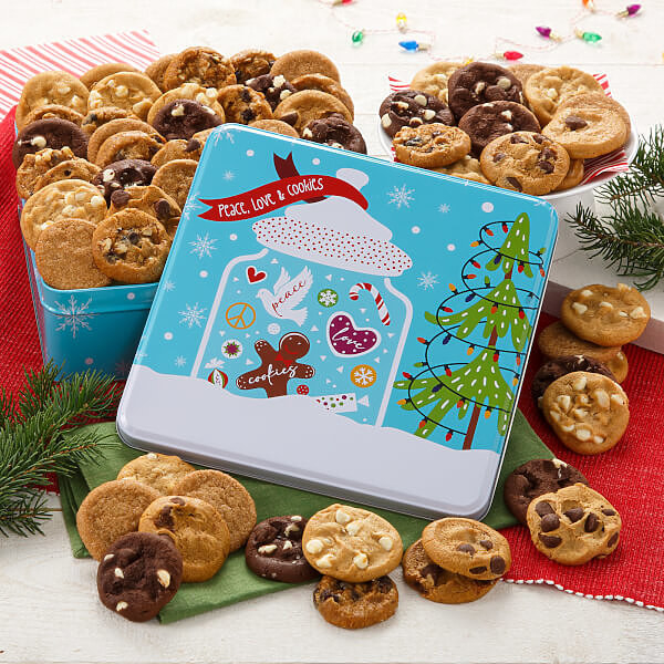 a blue mrs. fields tin filled with different cookies