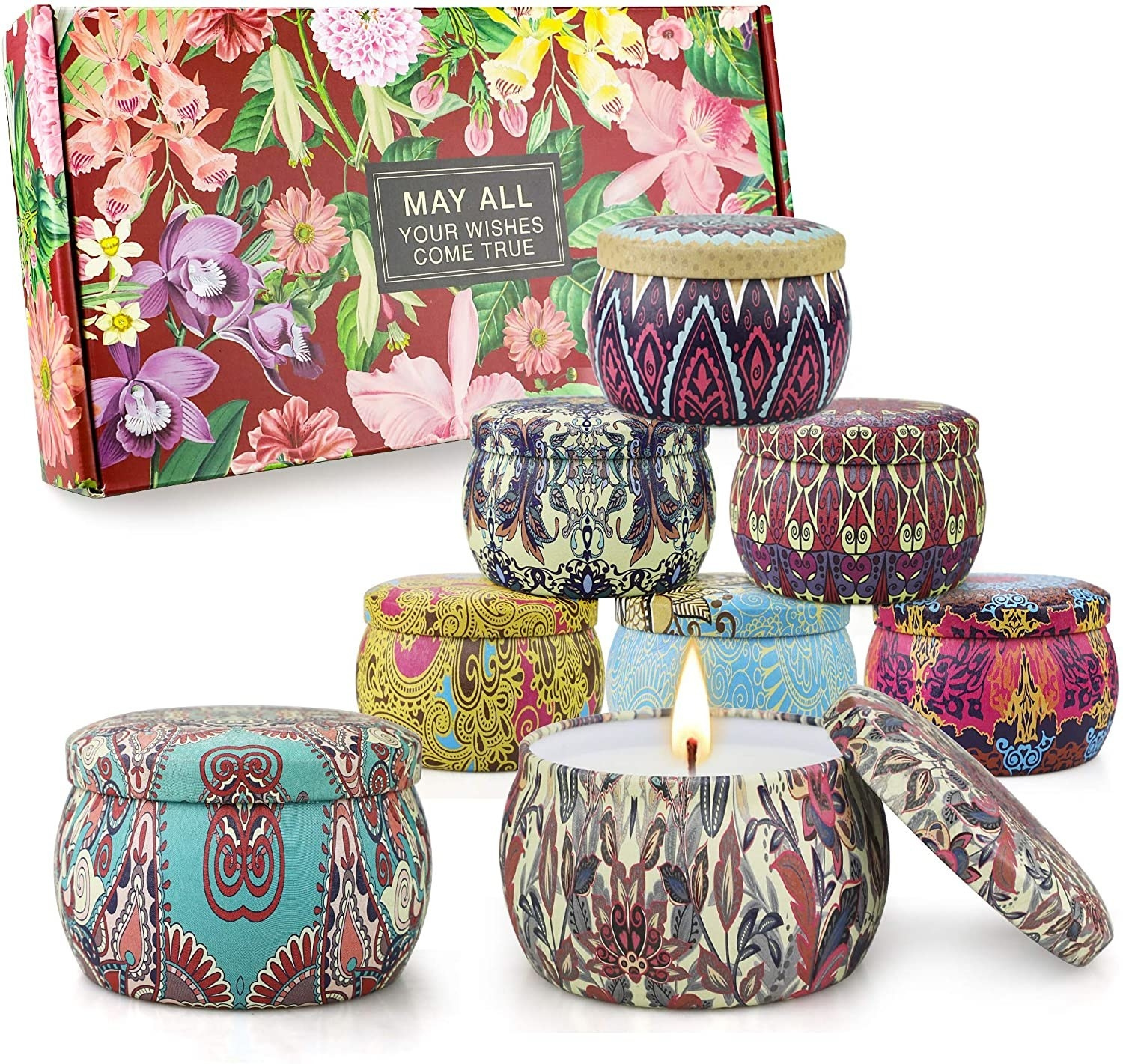 set of four candles in printed tins
