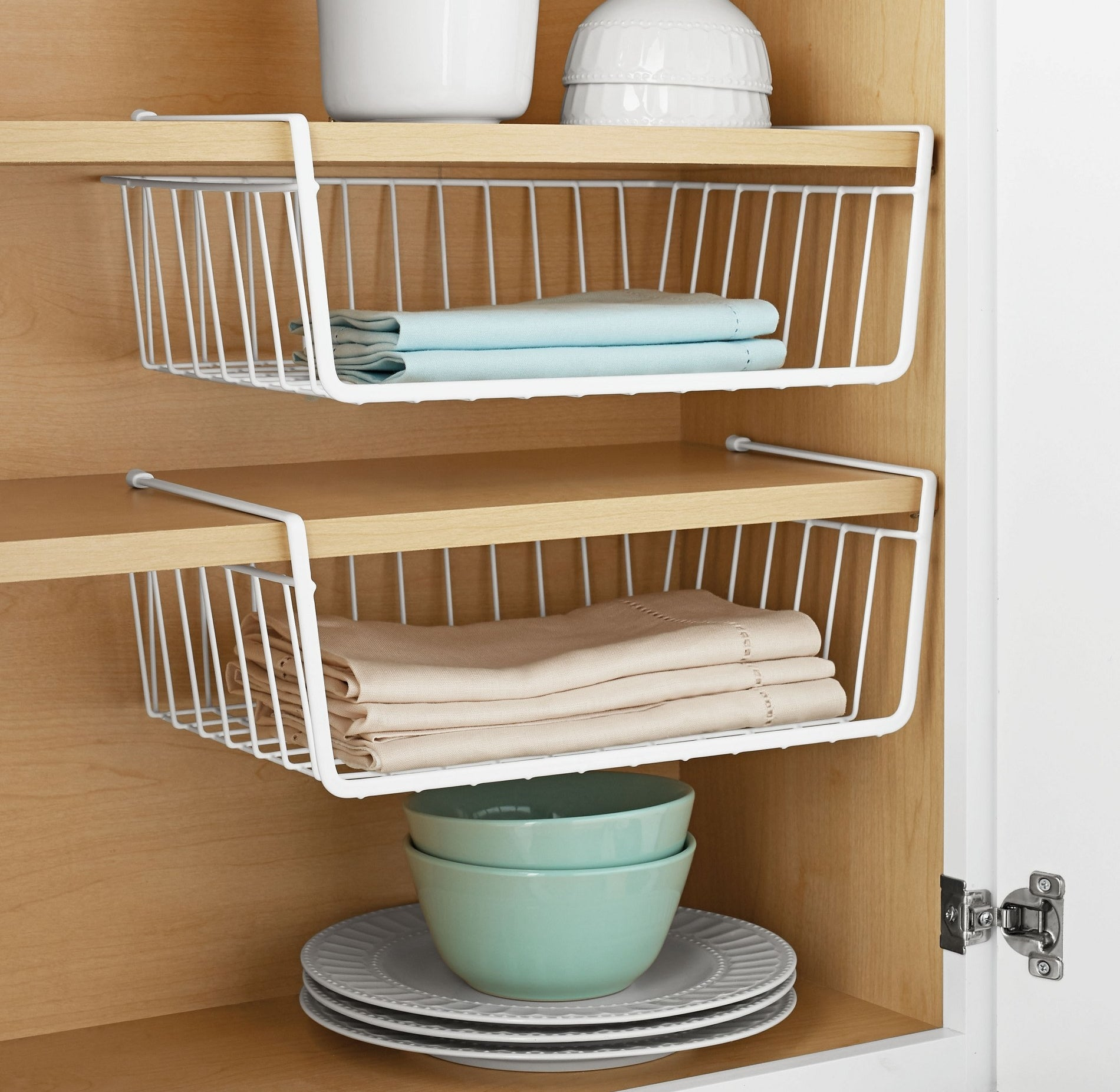 The baskets hung from cabinet shelves