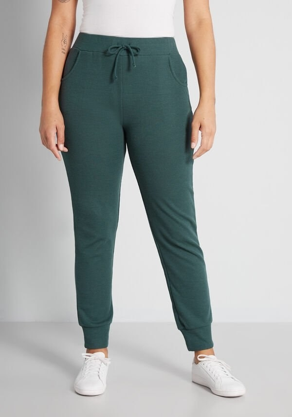 a model wearing the joggers in green