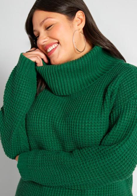 a model wearing the waffle knit sweater in green