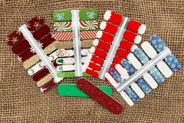 Nail polish strips in various holiday colors and patterns