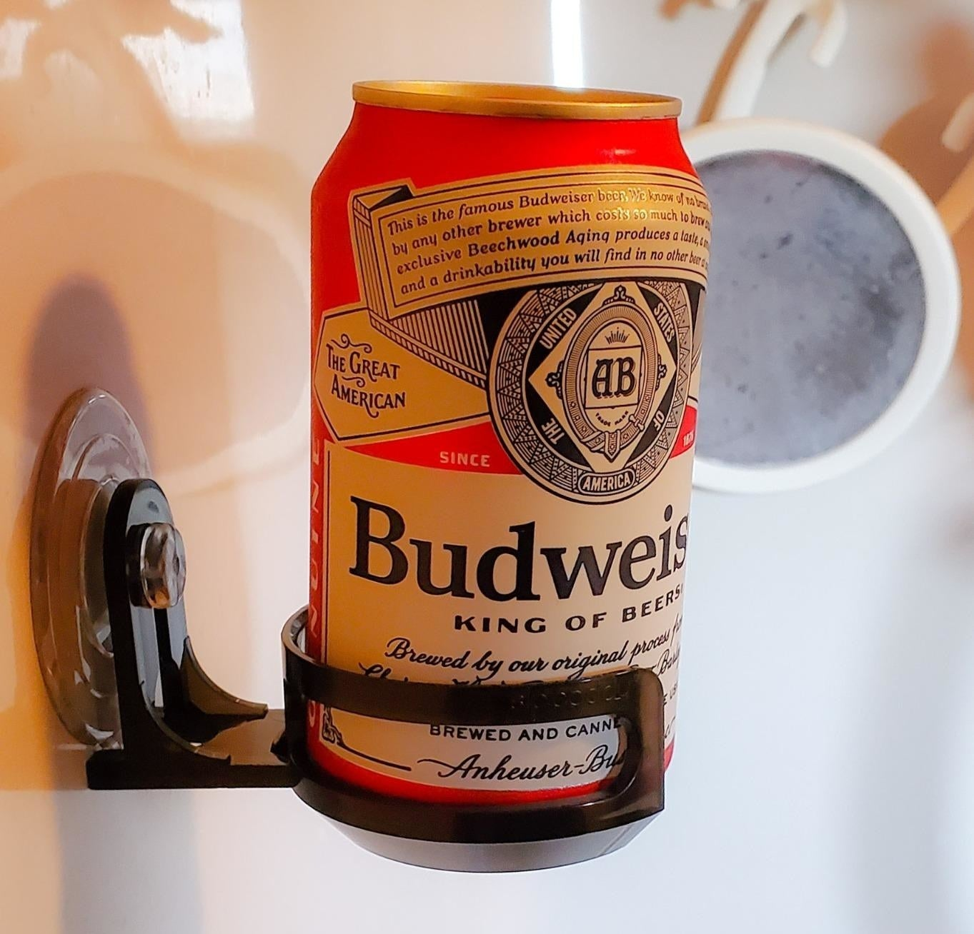 reviewer photo showing a can of beer in the suction cupholder