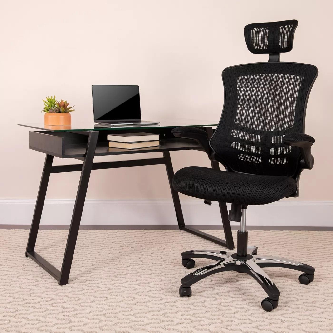 Black mesh high-back desk chair on wheels