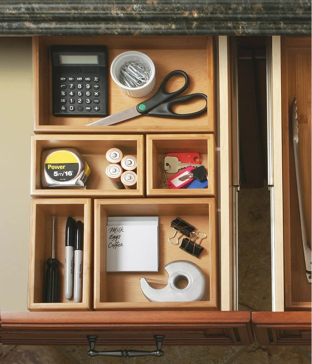 Bamboo desk organizers with office supplies