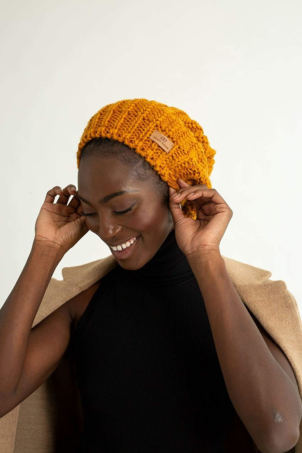 a model wearing the beanie in a mustard yellow color