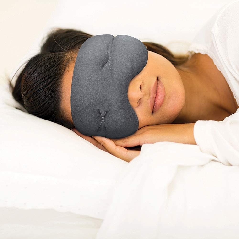 Model wearing the eye mask while lying on their side