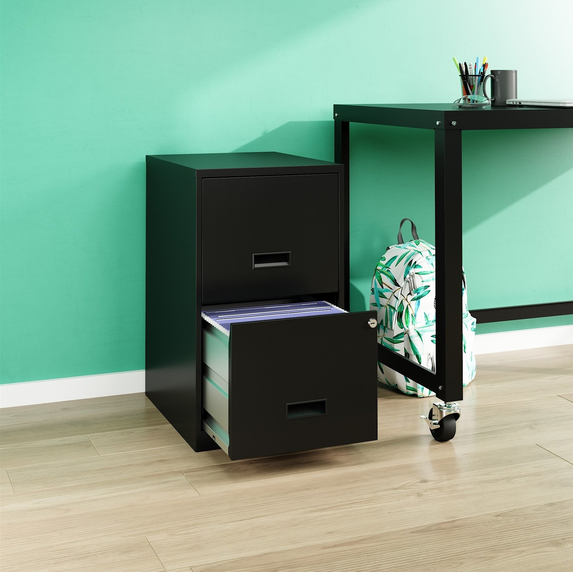The filing cabinet with bottom drawer opened