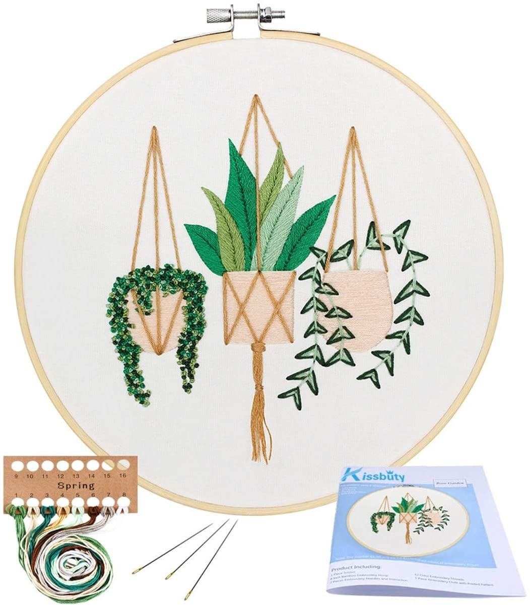 the parts of the kit with the final product that has three hanging plants