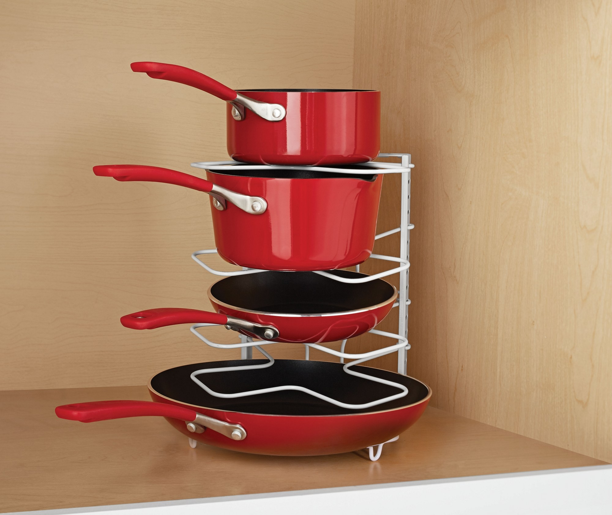 The wire rack with pans stacked between shelves