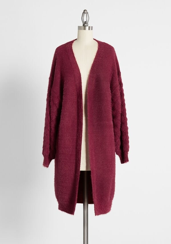 the crimson tunic with tapered sleeves on a mannequin