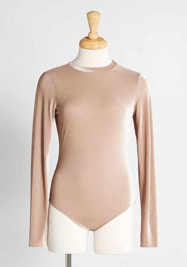 the sheer camel-colored bodysuit with long sleeves and a slight shimmer