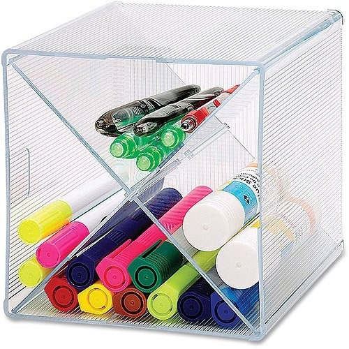 The cube with markers, pens, and glue sticks in compartments