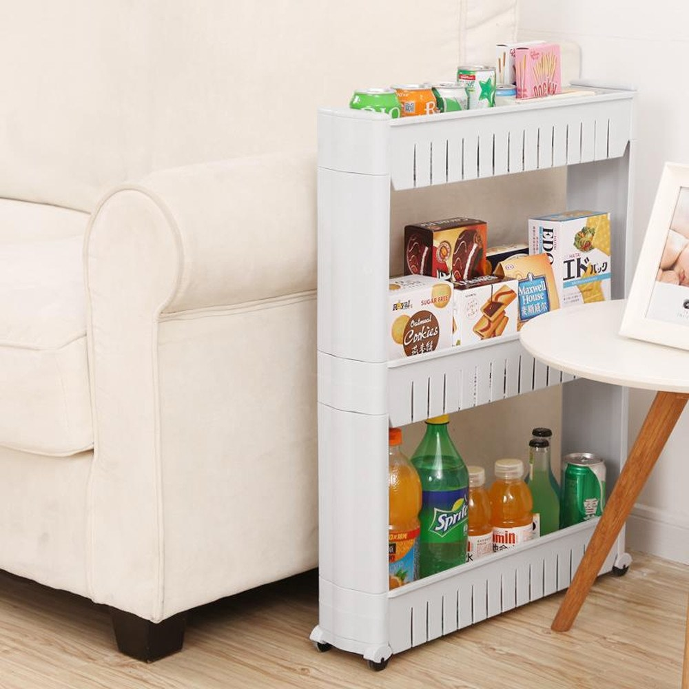 A full slide cart tucked between a couch and an end table