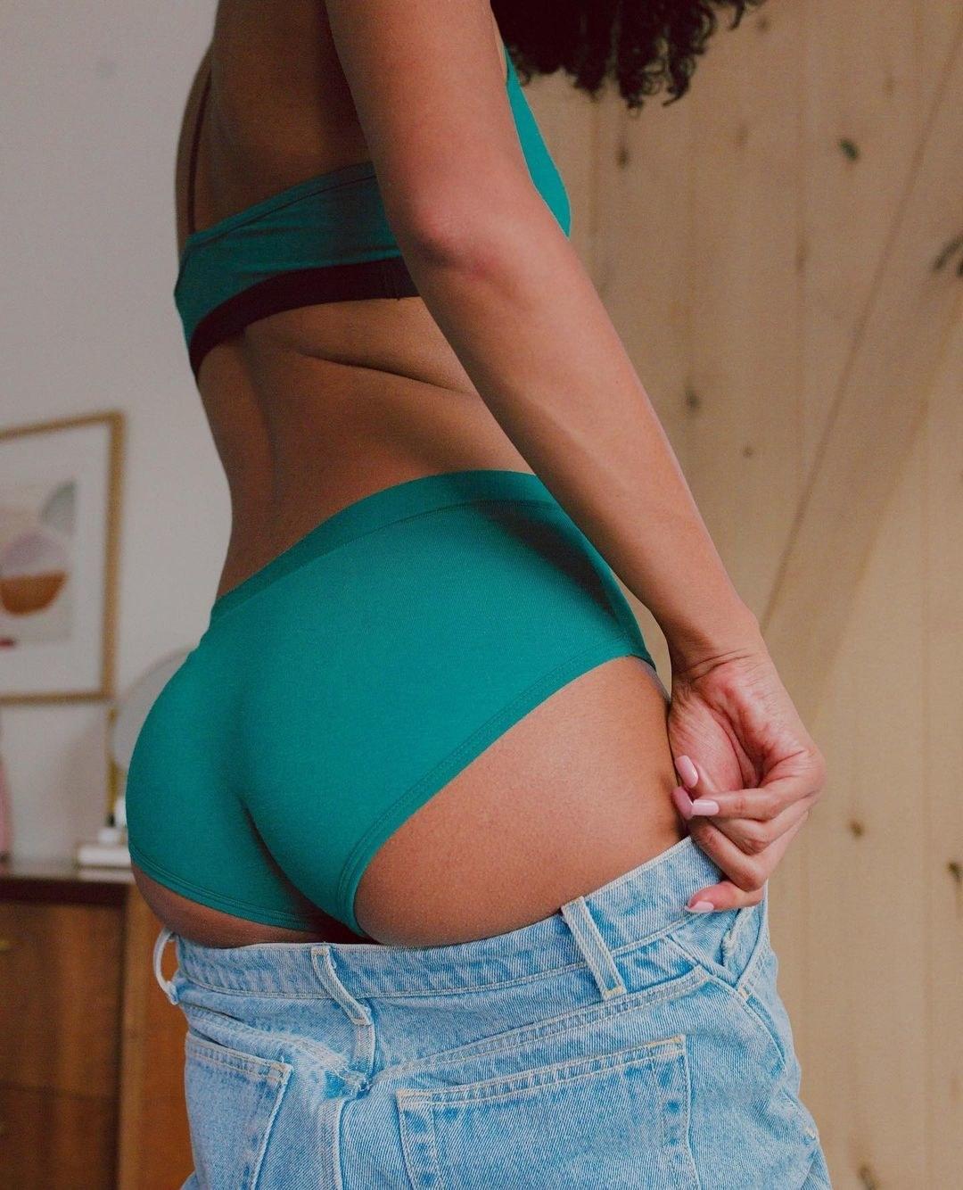 model wearing cheeky brief underwear in green