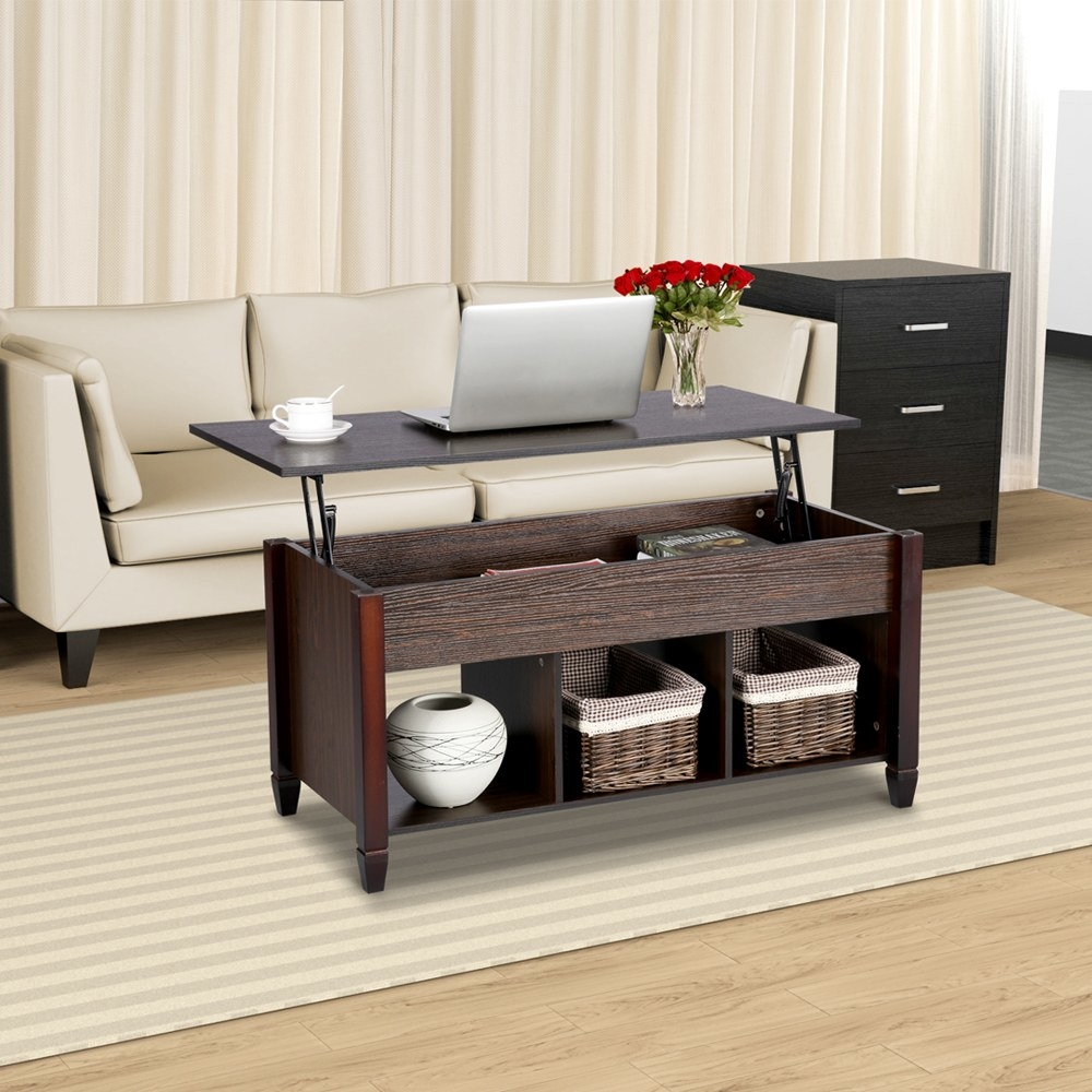 The coffee table with top up, revealing books inside