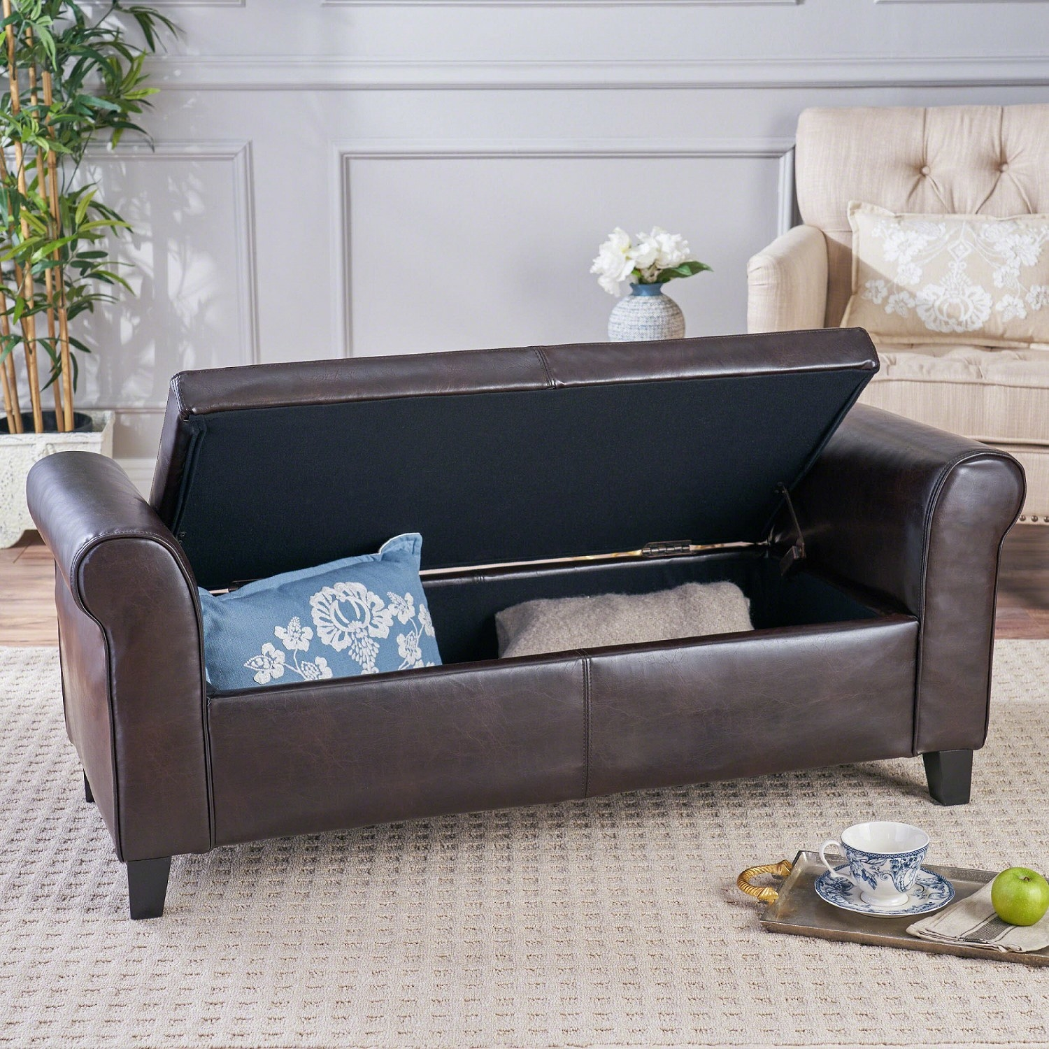 The bench with top up revealing a pillow and blanket inside