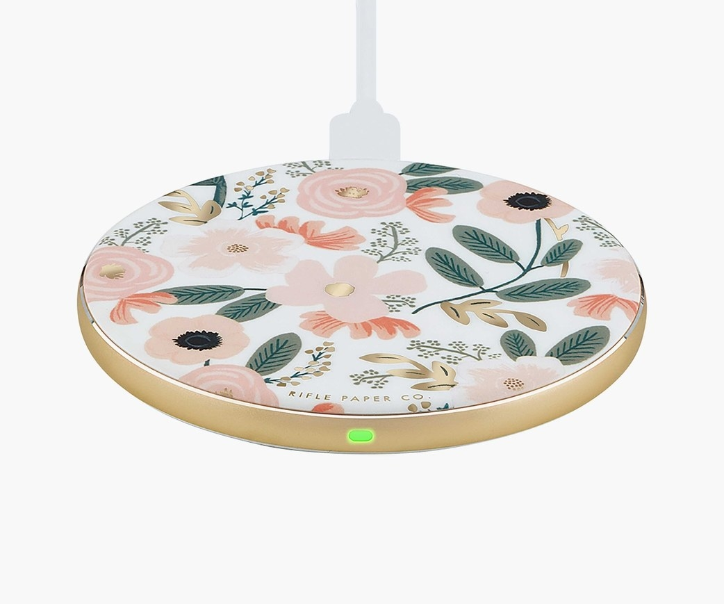 a circular charging station with a floral print on it