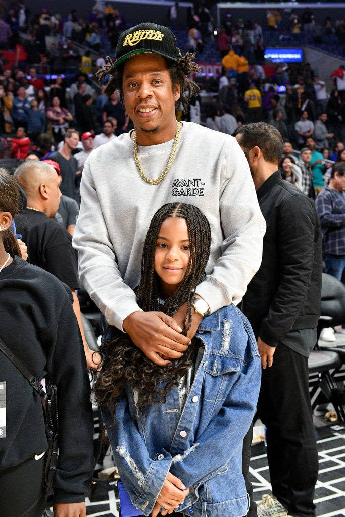 Blue Ivy and Jay-Z at a basketball game