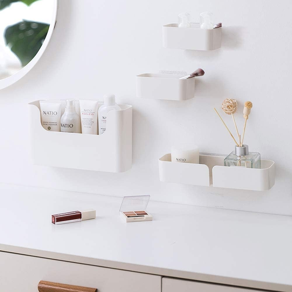 the white floating shelves with product inside