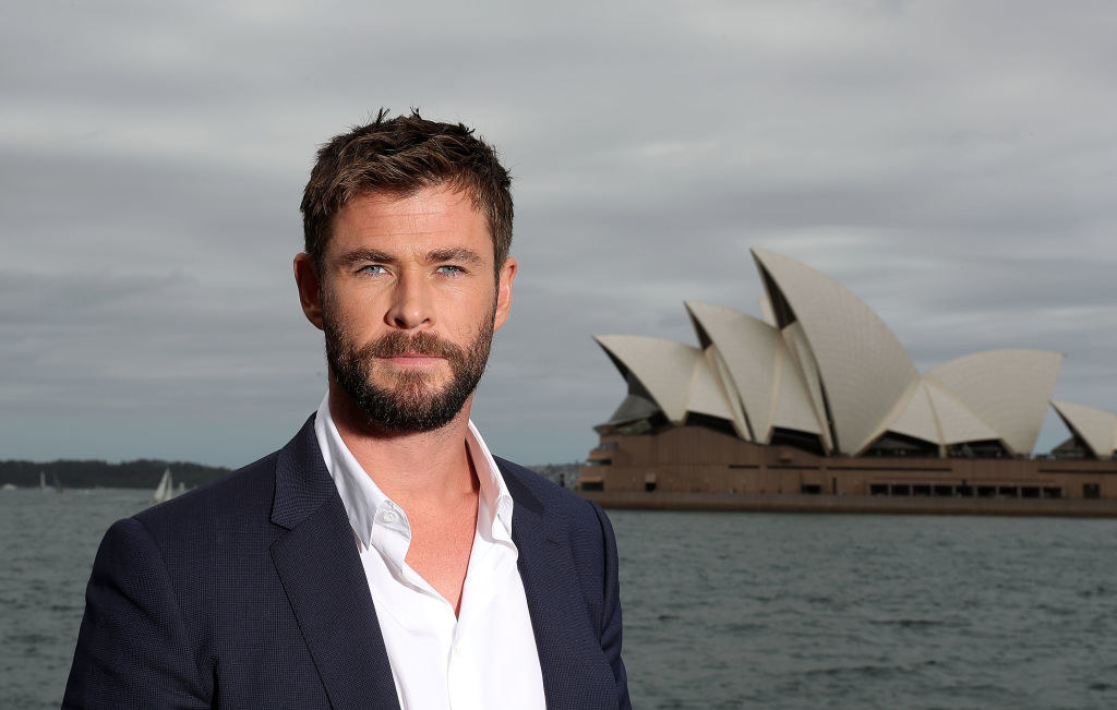 Chris Hemsworth with the Australian Opera House behind him