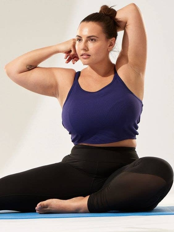 Model wearing the cropped cami in blue