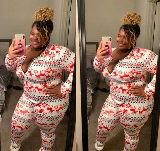 Reviewer wearing the onesie in a red and white holiday pattern
