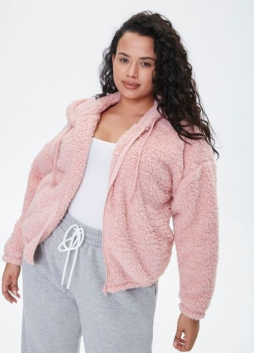 Model wearing the fuzzy hoodie in pink