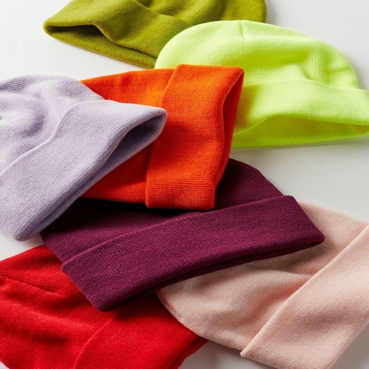 The knit beanies in orange, neon green, purple, and pink