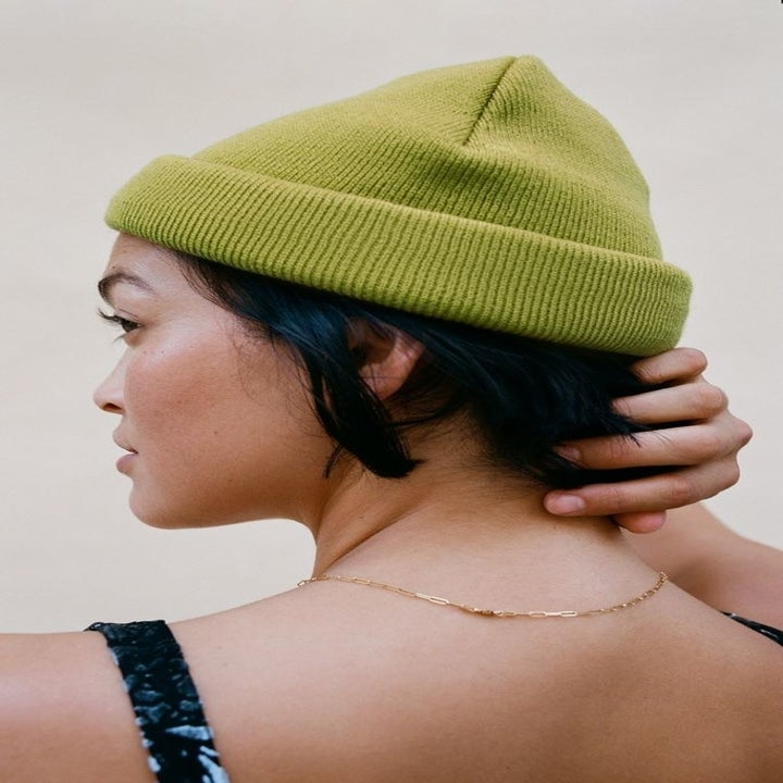 Model wearing the beanie in green