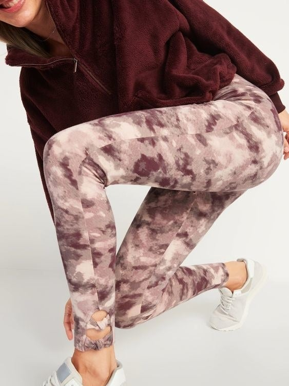 Model wearing the camo-print leggings in mauve