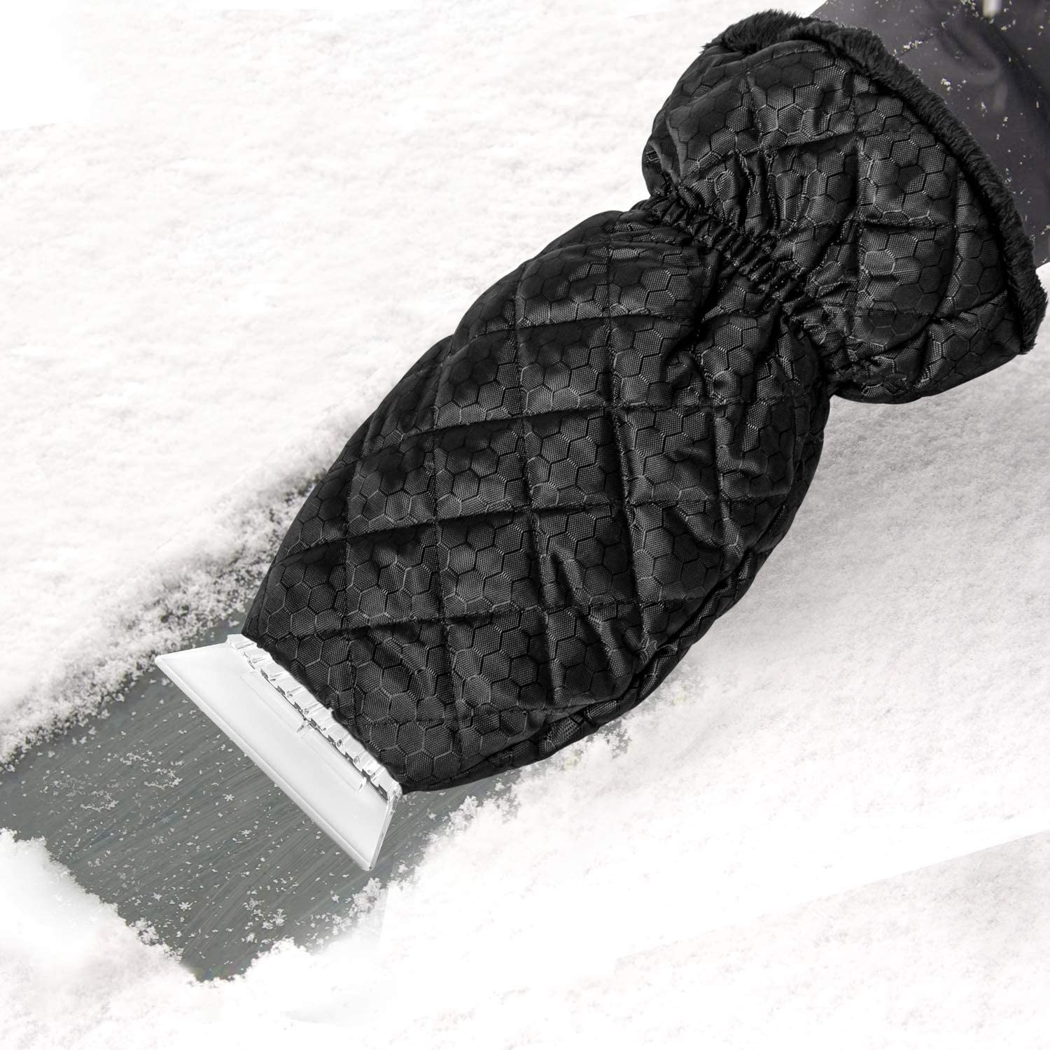 The ice scraper with attached gloved scraping snow and ice off of a windshield