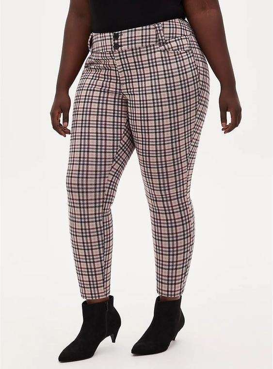 Model wearing the pink plaid skinny pants