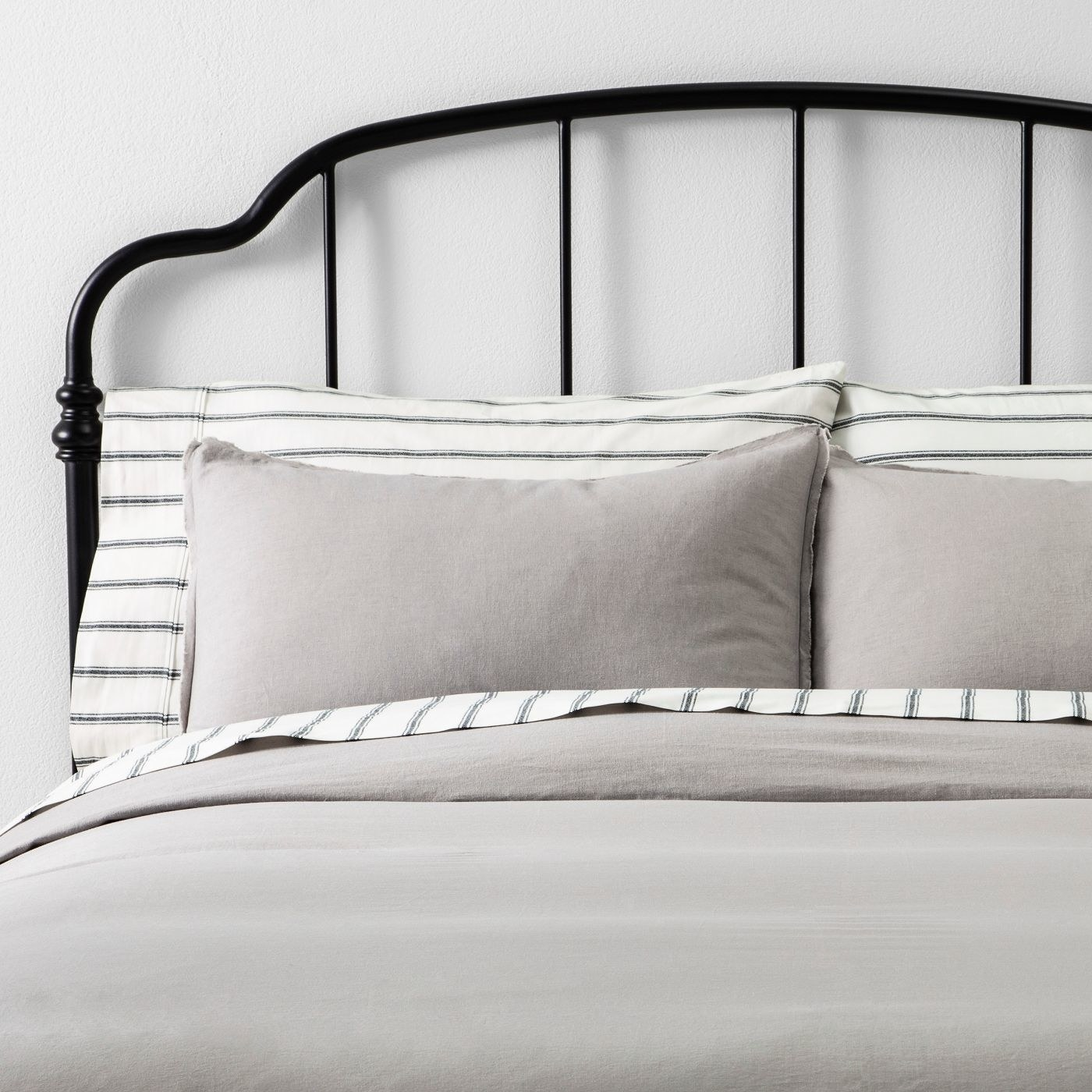 A grey duvet and matching grey sham pillow set