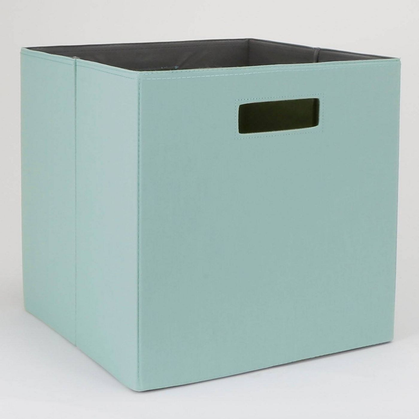 A teal storage cube