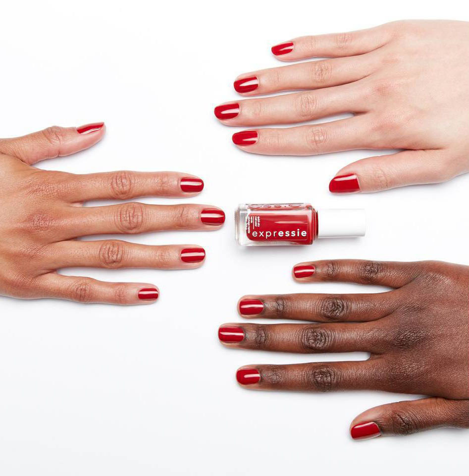 Red Expressie nail polish on three hands with different skintones