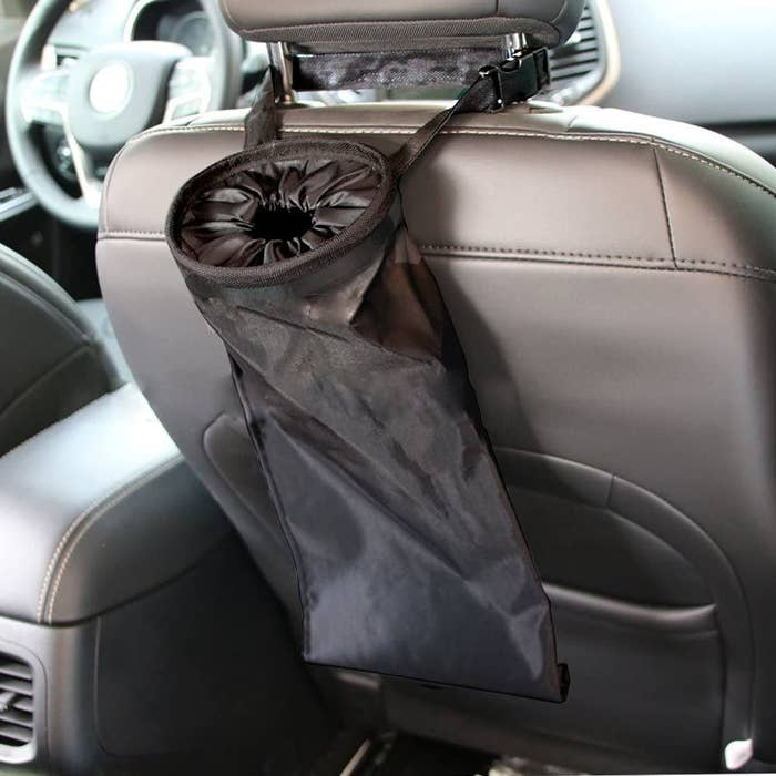 the black garbage bag attached to the back of the passenger seat
