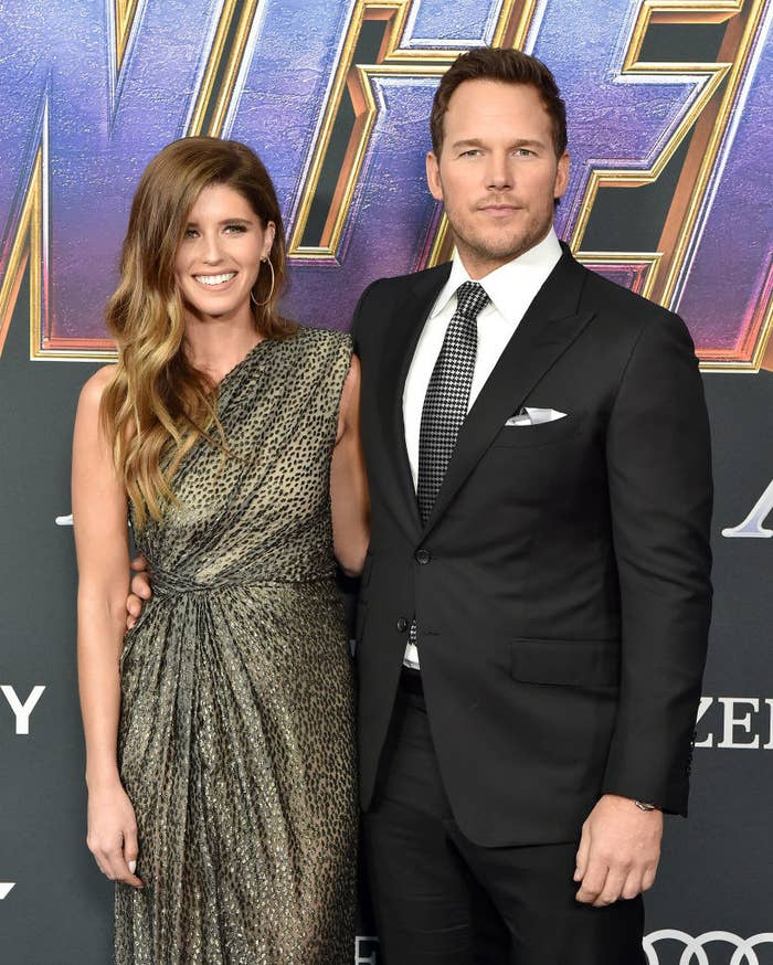 "Chris Pratt and Katherine Schwarzenegger stand on a red carpet in front of a sign reading ""Avengers: Endgame"""
