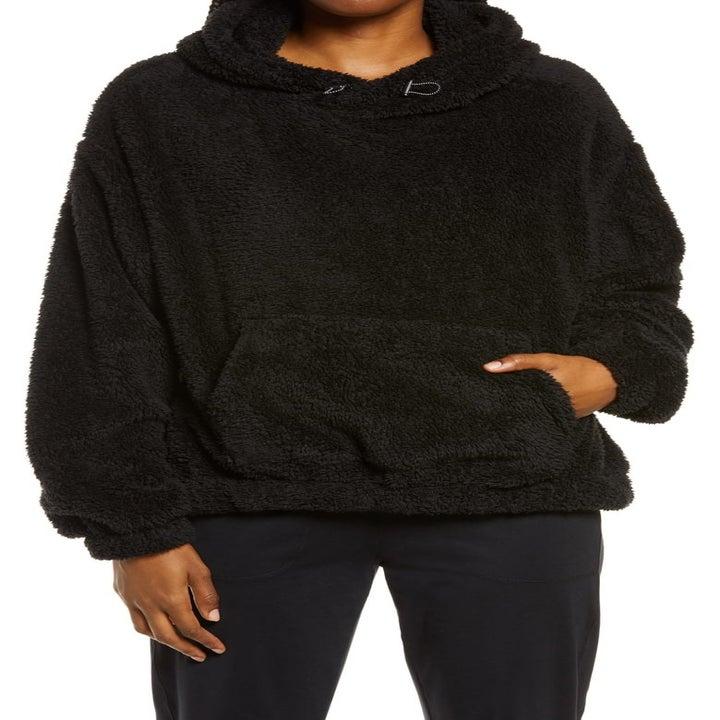 model wearing the black hoodie