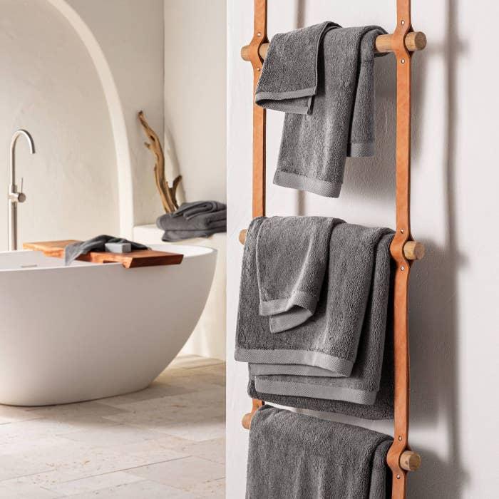 Dark Gray towels on a brown wood towel rack