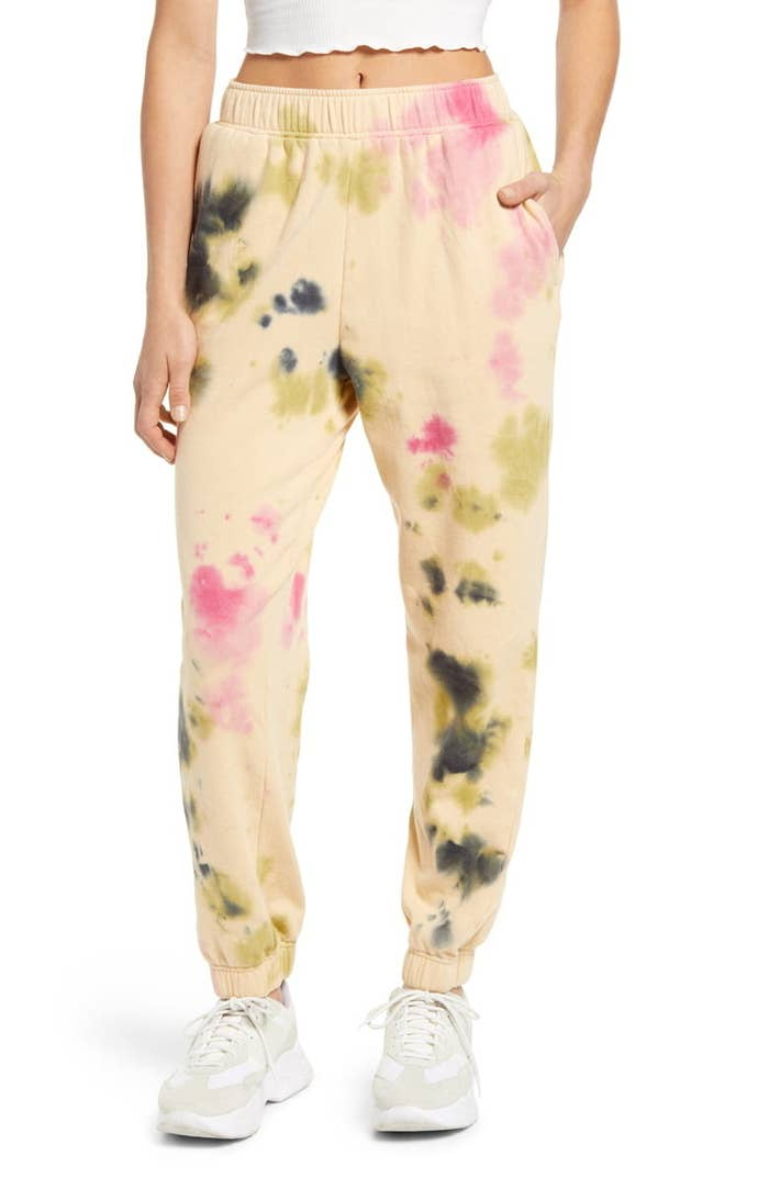 model wearing the yellow sweatpants with gray and pink tie dye