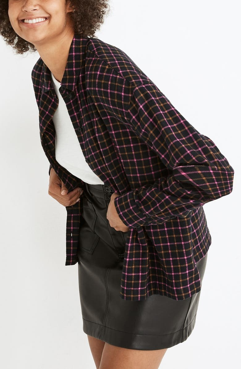model wearing the black green and pink flannel