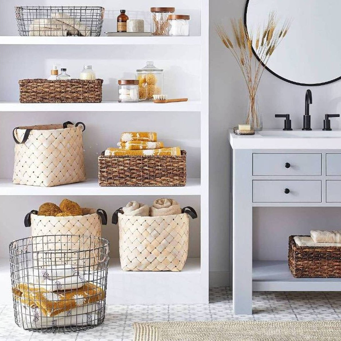 Wire storage basket with white and yellow towels inside