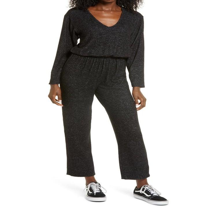 model wearing the dark gray jumpsuit
