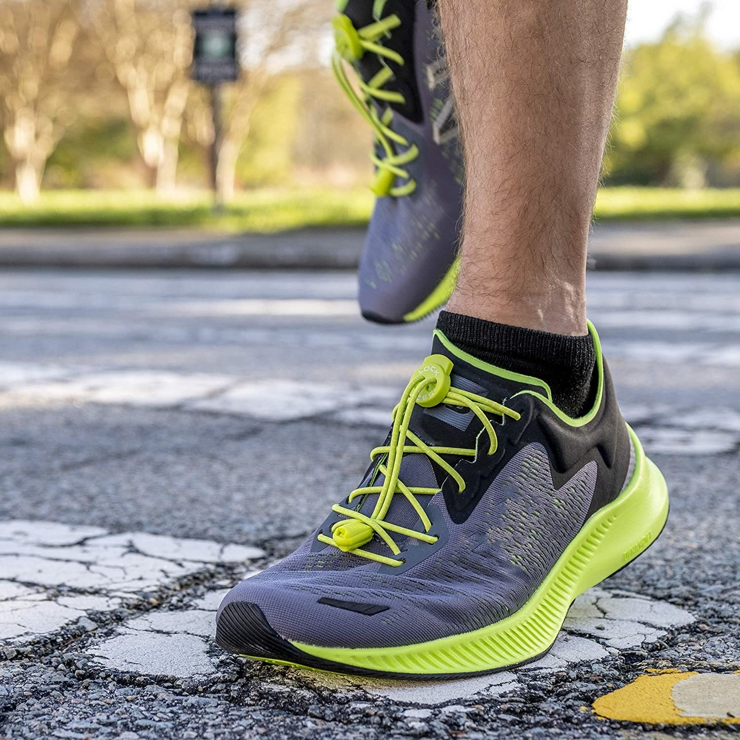 A person wearing the laces in their running shoes